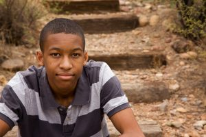 young black male sitting outside in the fall after getting Treatment for depression and therapy in Katy, TX 77494