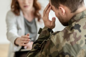 Male soldier attends trauma therapy for PTSD treatment in Katy, TX 77494 at the Counseling Center at Cinco Ranch