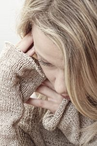 female trauma victim crying after a trauma flashback. Begin trauma treatment and at The Counseling Center at Cinco Ranch in Katy, TX 77494