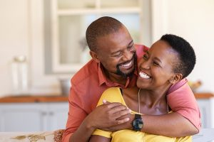 happy african american couple at home shows affection after couples therapy in katy tx at the counseling center at cinco ranch near Houston, TX 77494