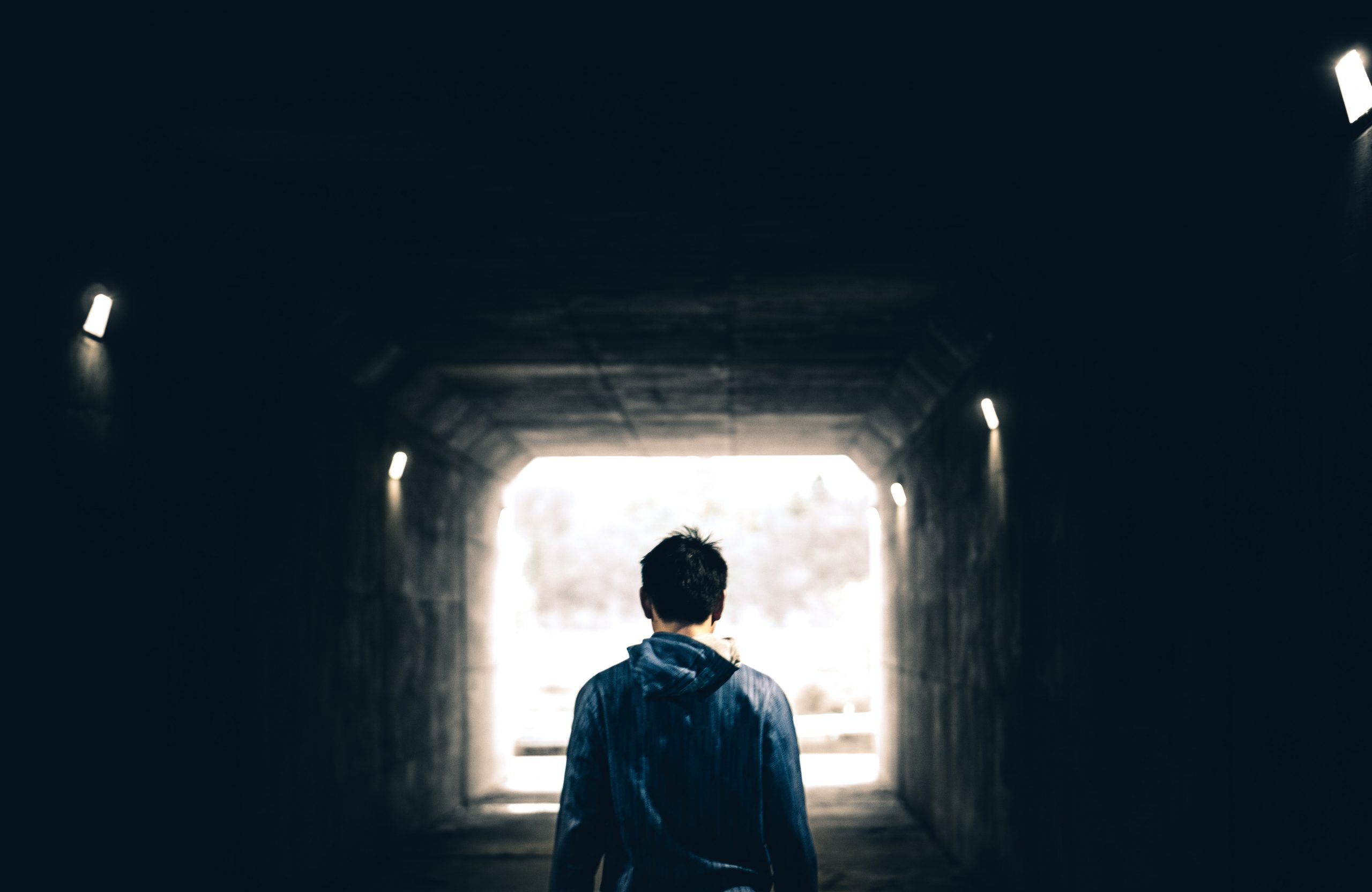 boy with anxiety in tunnel