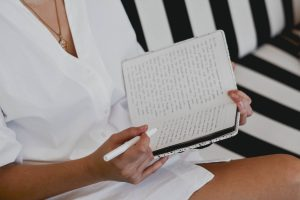 a woman practicing self-care by journaling after her depression counseling session in Katy, TX 77494