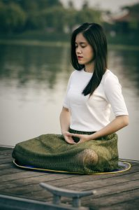 a woman practicing self-care by meditating after her counseling session in Katy, TX