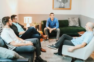 men at group therapy in Katy, TX working on men's issues such as anger management