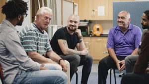 Men discussing mental health issues during their men's group in Katy, TX 77494