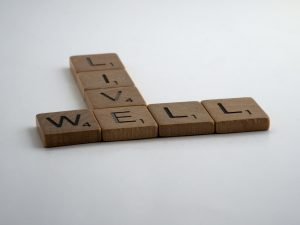 "Scrabble pieces that say ""live well."" Represent the need to learn about healthy boundaries in therapy in Katy, TX 77494"