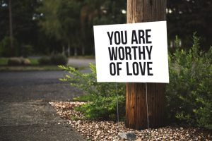 A sign that says you are worthy of love. Represents the need for self-compassion counseling in Katy, TX 77494